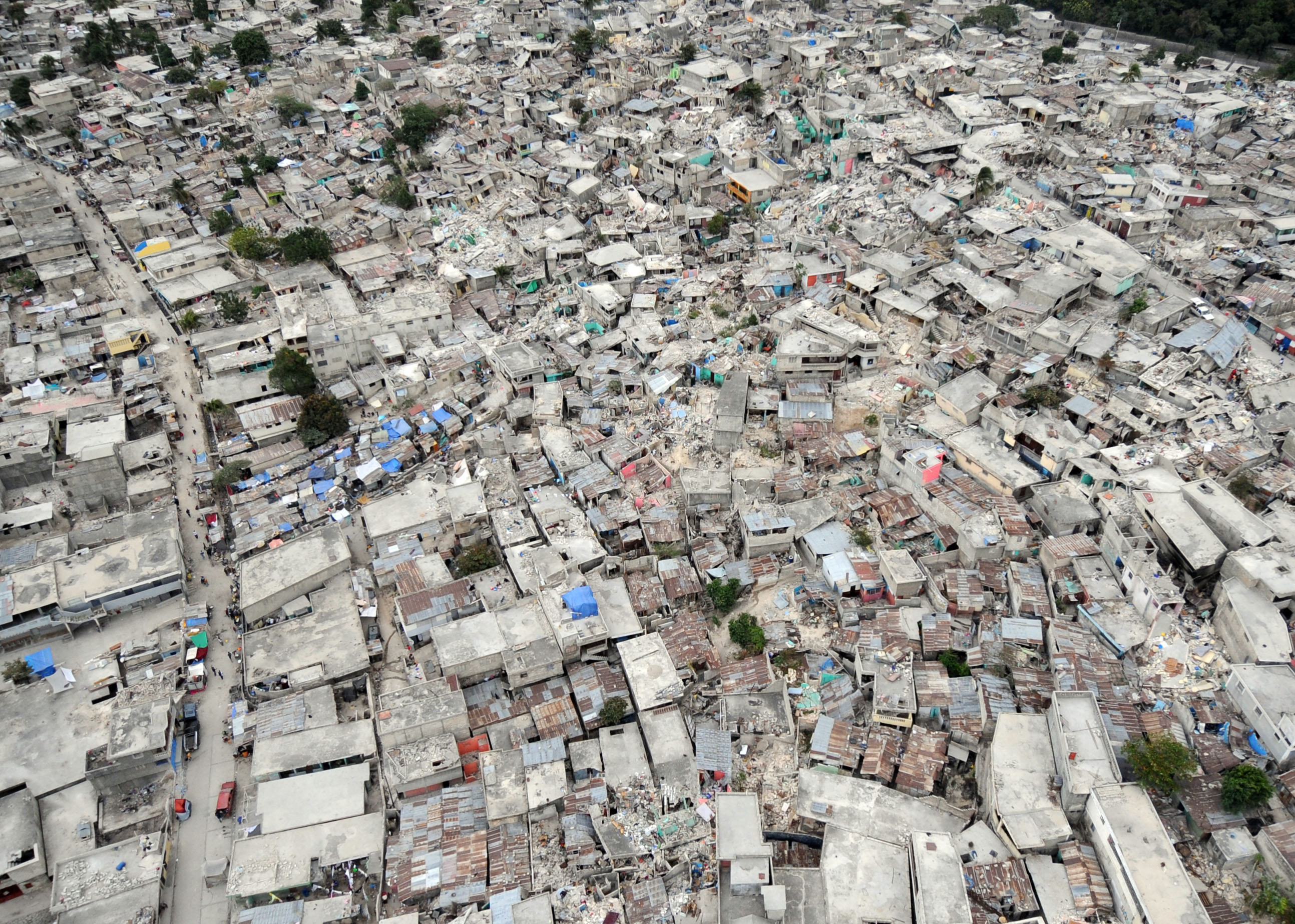 The_earthquake_damage_in_Port-au-Prince_Haiti_is_photographed_Jan._30_2010_during_Operation_Unified_Response_100130-N-HX866-001